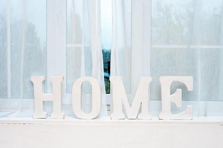 windowsill: Rustic interior decor. Word Home on windowsill Stock Photo