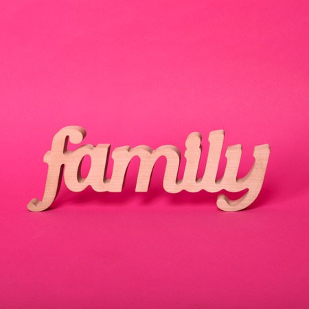 gratefulness: Word family, wooden letters on pink paper background. Love and unity concept