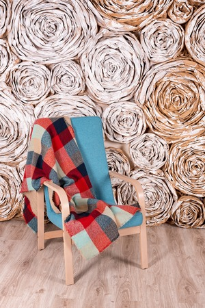 room decoration: Loft interior with cozy armchair and blanket Stock Photo