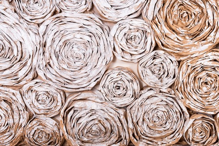 Wall with paper flowers. Handmade craft creative abstraction background