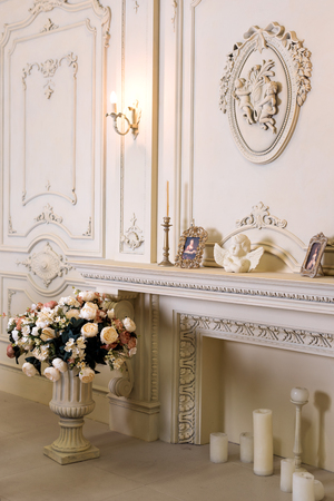 comfortable: Luxury apartment, comfortable classic living room. Luxurious vintage interior with fireplace in the aristocratic style