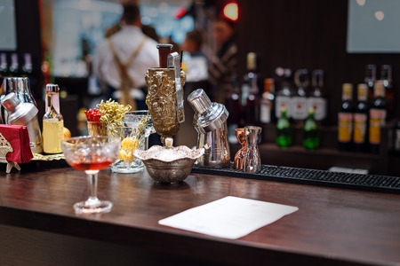 Set of bar accessories and ingredients for making a cocktails on counter.
