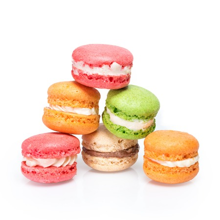 Colorful macaroons isolated on white. Traditional french dessert macarons. Stock Photo