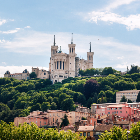 Colorful houses of Lyon and Fourviere Basilica from the Saone riverbank, France Stock Photo