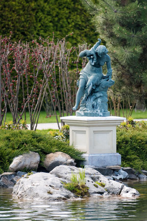 angels fountain: Fountain with statue of a woman in the park near the lake