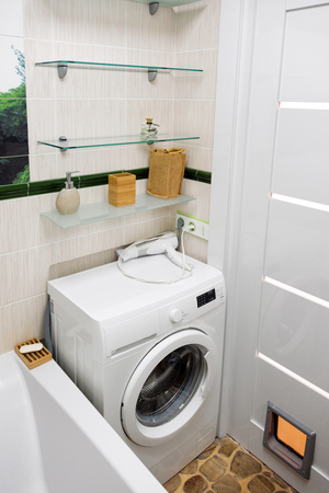 bathroom mirror: Small modern bathroom interior. Well organized space. Stock Photo
