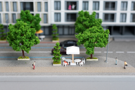 Miniature model, miniature toy buildings, cars and people. City maquette. 版權商用圖片
