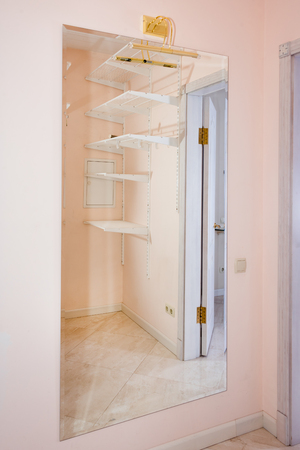 modular home: Empty walk-in closet with shelves. Dressing room Interior elements.