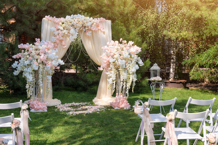 Wedding arch decorated with cloth and flowers outdoors beautiful wedding arch decorated with cloth and flowers outdoors beautiful wedding set up wedding ceremony junglespirit Gallery