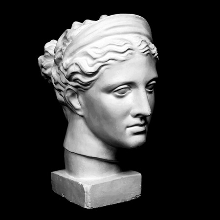 Marble head of young woman, ancient Greek goddess bust isolated on pink background with space for text.
