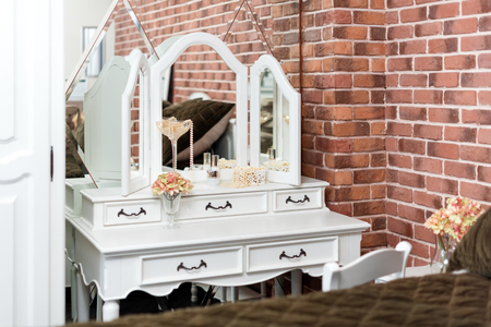 Dressing table in the boudoir. Details of woman bedroom interior.