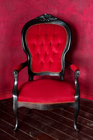 Classical style armchair. Antique wood sofa couch in vintage room.