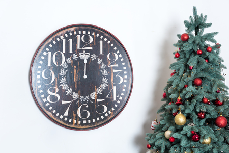 fireplace: Christmas background. Winter holidays background with clock and decorated christmas tree. New Year is coming.