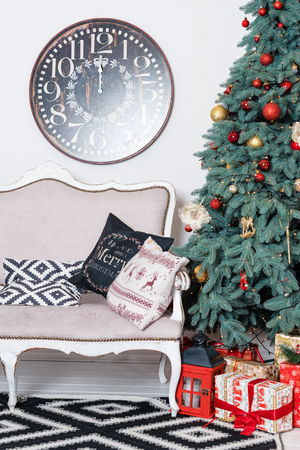 fireplace: Beautiful Christmas interior. New year decoration. Comfort home. Classic new year tree and christmas presents in boxes.