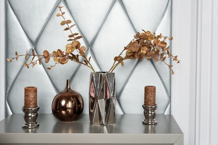 Vase with dried flowers and candles. Living room decor