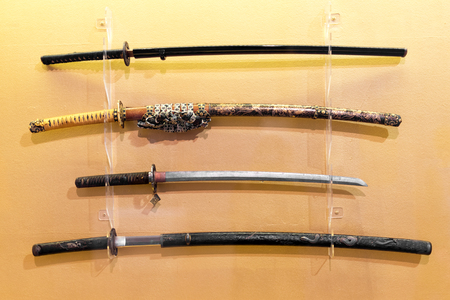 Collection of Japanese Katana, Daito, Wakizashi, Tanto Samurai swords Stock Photo
