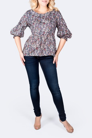 Unrecognizable model wearing casual outfit posing on grey neutral background Stock Photo