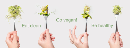 Woman hand holding micro greens on fork. Healthy eating, fresh garden produce organically grown. Symbol of health and vitamins from nature. Microgreens, vegan and vegetarian diet concept. Go vegan Stock Photo