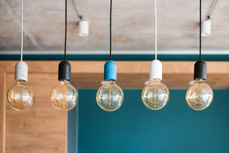 Edison retro lamps. Incandescent bulbs on grey wall background in loft. Concept of vintage style Imagens
