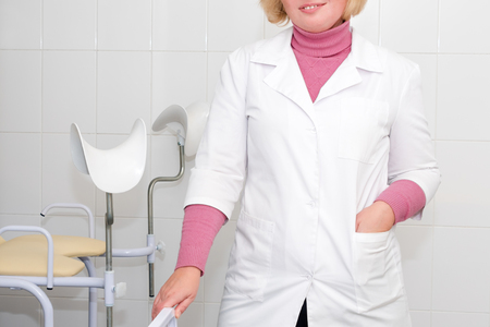 Gynecologist waiting for the next patient with a colposcope, check up healthcare. Equipment medicine, medical furniture, hospital, genicology, womens consultation Imagens