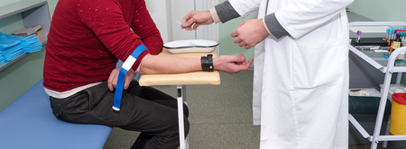 Preparation for blood test. Medical technician preparing before taking a blood sample from patient.