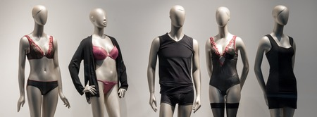 Modern and luxury shop of underwear. Full-length male and female mannequins in nderwear. Lingerie on plastic dolls in store window display.