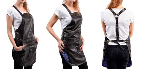 Young redhaired woman chef or waiter posing, wearing apron and t-shirt isolated on white background. Stok Fotoğraf