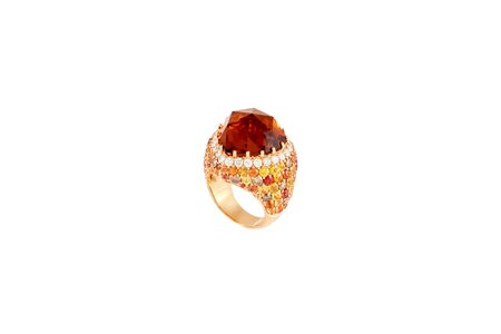 Golden diamond ring isolated on white background. Ring with diamonds and precious color gemstones. Luxury jewelry, yellow gold. Reklamní fotografie - 128705651