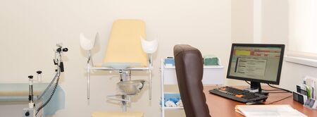 Gynecological cabinet with chair and other medical equipment in modern clinic. Equipment medicine, medical furniture, hospital, genicology, womens consultation Reklamní fotografie