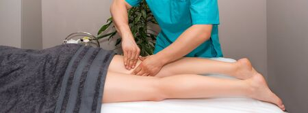 Professional therapist giving relaxing leg massage treatment to a woman in spa. Relaxing spa procedures, whole body massage. Pleasure, rest, body care, beauty, alternative medicine, stress relief Imagens