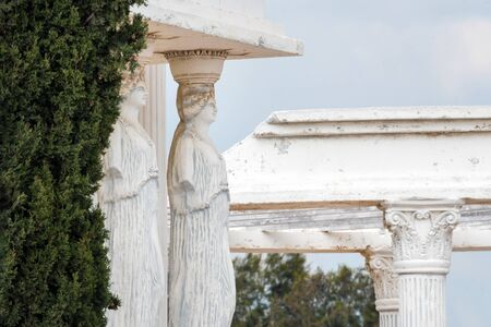 Caryatids statues on a porch in the park. Replica of ancient greek statues.