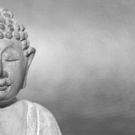 Wooden statue of Buddha, symbol of Buddhism. Free copyspace for text.
