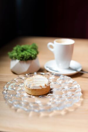 Cream tart with coffee. Dessert in cafe, selective focuse. Stock Photo