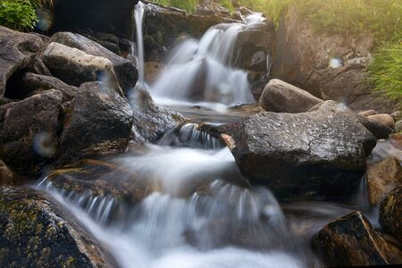 Waterfall at the forest in long exposure. Carpathian mountains, Hoverla, Ukraine.