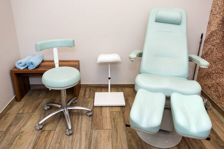 Chairs in a pedicure beauty salon. Interior of empty modern nail salon. Work places for masters of manicure. Pedicure cabinet