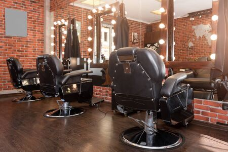 Stylish Vintage Barber Chairs. Modern hairdresser and hair salon, barber shop for men.