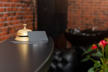 Hotel reception counter desk with service bell. Hotel Concierge call bell.