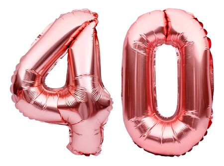 Number 40 forty made of rose golden inflatable balloons isolated on white. Helium balloons, pink foil numbers. Party decoration, anniversary sign for holidays, celebration, birthday, carnival.