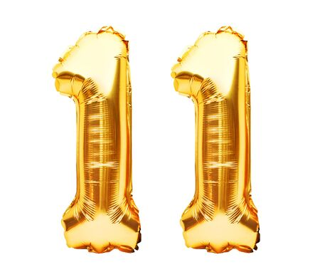 Number 11 eleven made of golden inflatable balloons isolated on white. Helium balloons, gold foil numbers. Party decoration, anniversary sign for holidays, celebration, birthday, carnival.