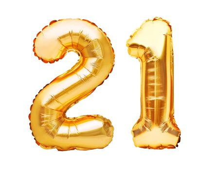 Number 21 twenty one made of golden inflatable balloons isolated on white. Helium balloons, gold foil numbers. Party decoration, anniversary sign for holidays, celebration, birthday, carnival.