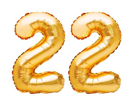 Number 22 twenty two made of golden inflatable balloons isolated on white. Helium balloons, gold foil numbers. Party decoration, anniversary sign for holidays, celebration, birthday, carnival Imagens - 148629920
