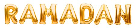 Word RAMADAN made of golden inflatable balloons isolated on white background. Helium balloons gold foil. Concept of holy month of Ramadan and Eid al Fitr, great islamic muslim holiday.