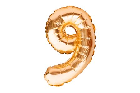 Number 9 nine, made of golden inflatable helium balloon. Gold foil balloon font part of full set of numbers, isolated on white. Birthday party celebration, sales and discounts concept