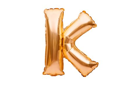 Letter K made of golden inflatable helium balloon isolated on white. Gold foil balloon font part of full alphabet set of upper case letters Stock fotó