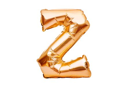 Letter Z made of golden inflatable helium balloon isolated on white. Gold foil balloon font part of full alphabet set of upper case letters