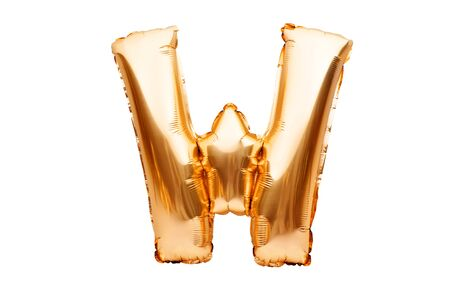 Letter W made of golden inflatable helium balloon isolated on white. Gold foil balloon font part of full alphabet set of upper case letters. Celebrating decoration