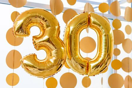 Golden balloons with ribbons - Number 30. Party decoration, anniversary sign for happy holiday, celebration, birthday, carnival, new year. Metallic design balloon