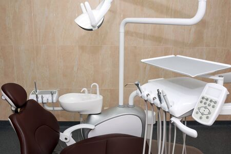 Dentist office. Modern dental cabinet. Dental instruments and tools in modern clinic, professional dentistry chair waiting to be used by orthodontist.