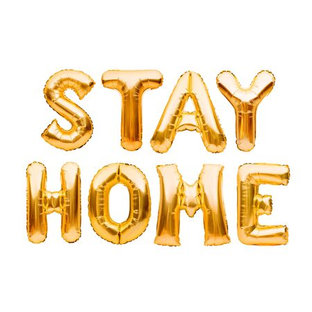 Words STAY HOME made of golden inflatable balloons. Quarantine, protection from Coronavirus or Covid-19 epidemic, social media campaign for coronavirus prevention