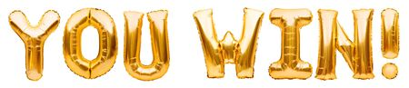 Words YOU WIN made of golden inflatable balloons isolated on white. Helium balloons gold foil letters. Message for winner, champion. Business concept for winning in a competition or a lottery